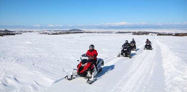 Snowmobilers on a trail in Rimouski