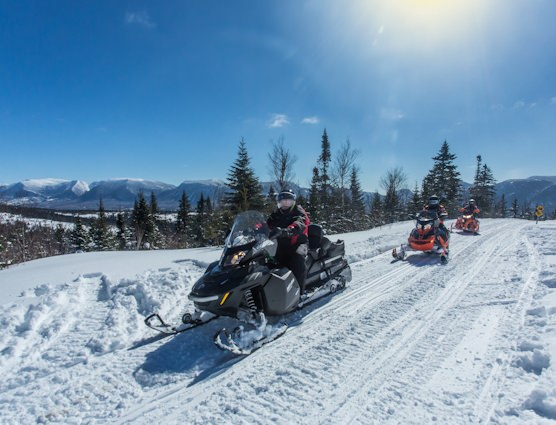 Snowmobilers in the Chic-Choc Mountains in Gaspésie